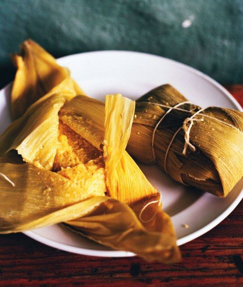A classic pre-Hispanic treat, humitas are made with fresh grated corn and flavorings—in Chile, that means basil and onions—wrapped and tied in a corn husk and steamed.