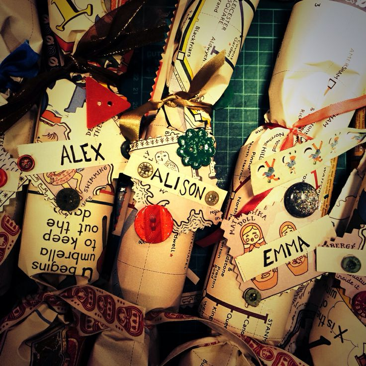 Homemade crackers make from a toilet roll, a poster and some scraps of ribbon