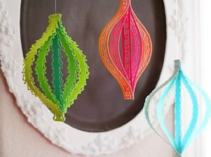 Colorful paper ornaments. If you need something new to spice up your tree, try these easy, modern DIY ornaments from Lisa Storms. Using border punches, she punched out patterns in colorful strips of paper in different lengths, and stapled together the ends so they buckle in the shape of an ornament.