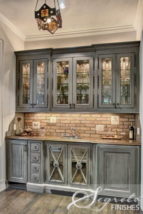 Grey washed cabinets. Also love the brick. fun for a little bar area