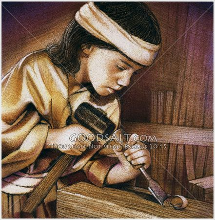 A young carpenter boy carving wood.