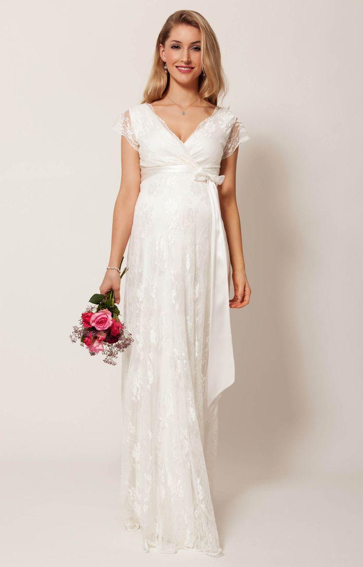 Tel un rêve d'ivoire, laissez-vous conduire jusqu'à l'autel, resplendissante dans votre robe en dentelle à fleurs.