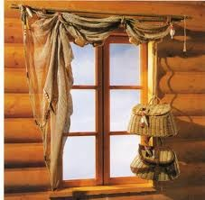 fish net, toulle...yeah...i love a-symetrical   window treatments....would do this with other materials...