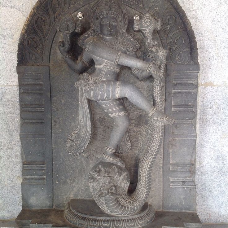 Single stone sculpture of Goddess Lakshmi dancing in natarajasana pose on a serpent head - udupi, India