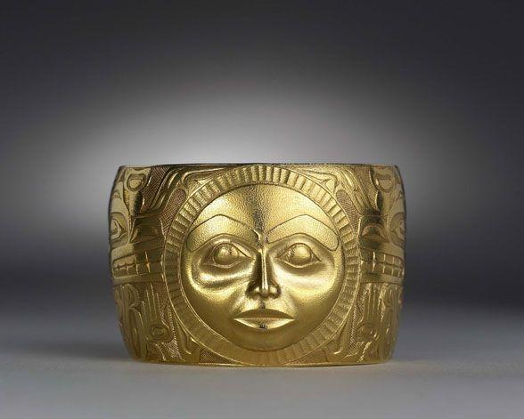 Bracelet with Moon Mask design  By Bill Reid (1972) 22k gold, repoussé, engraved, textured