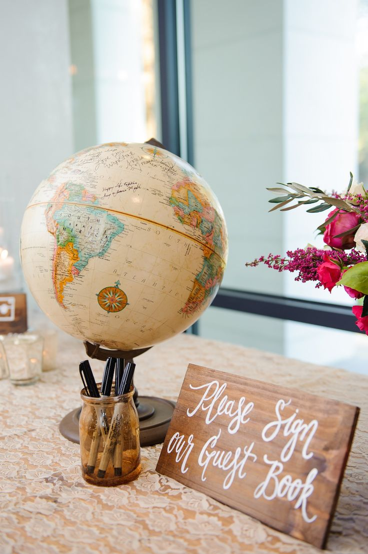 World Globe Guest Book Display  Photography: Sarah & Ben Read More: http://www.insideweddings.com/weddings/florida-wedding-celebration-with-vibrant-colors-and-wooden-details/644/
