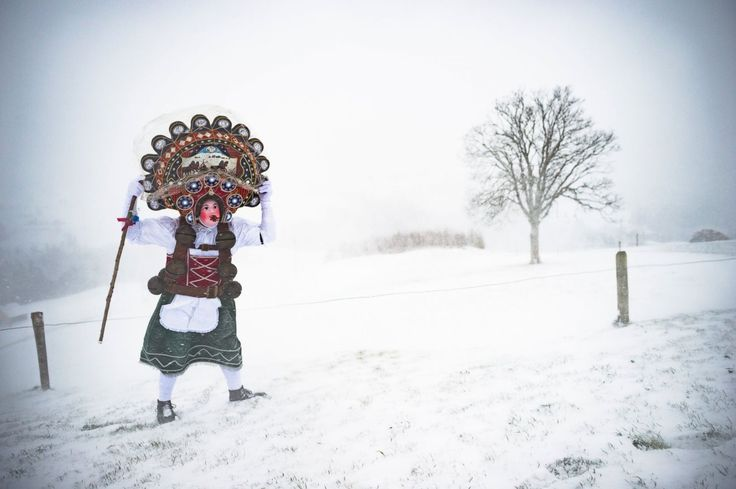 "A traditional, masked ""Silvesterchlaus"" walks through Waldstatt, Switzerland, Jan. 13, 2016, to offer the best wishes for the New Year of the Julian calendar to the farmers in this region. After their performance of singing and dancing the Silvesterchlaeuse receive hot drinks."