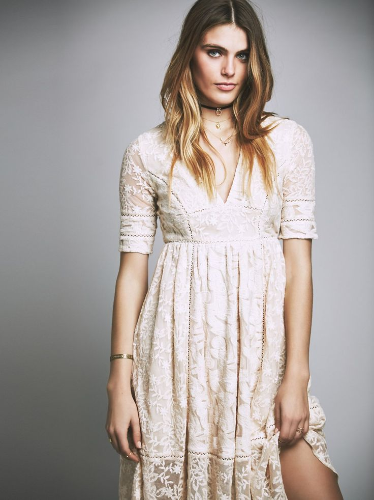 Mountain Laurel Dress | Lace crochet midi dress featuring a V-neckline and short sleeves. This A-line silhouette has a flowy skirt and a sheer lace hem. Lined.