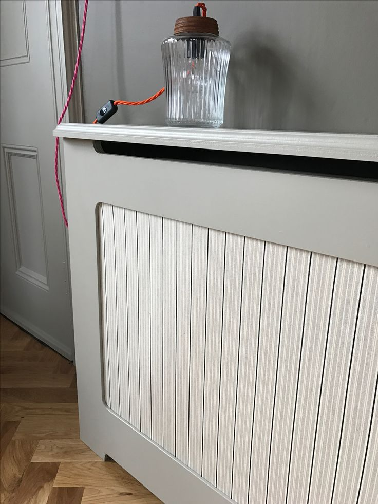 Radiator cover finished with Ian Mankin Vintage Stripe