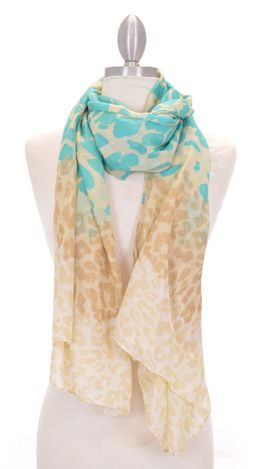 Long, lightweight scarf with teal and taupe animal print over an ivory background. $19 at shopbluedoor.com