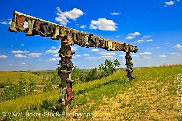 Cowboy boots hanging at the entrance to The Great Sand Hills near Sceptre, Saskatchewan, Canada.