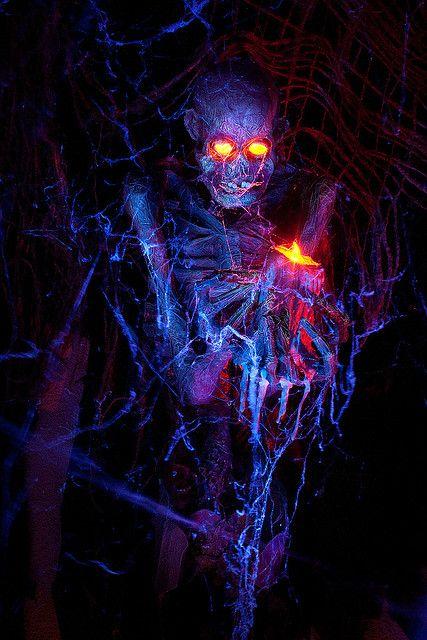 Led lights in skull eyes in graveyard for Halloween display