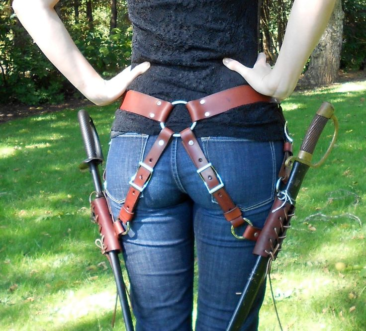 Dual Sword Belt (SM). $130.00, via Etsy. The ring at the back allows the weight of the swords to distribute evenly across the bearer's hips, and the angled frogs make drawing the swords much easier.