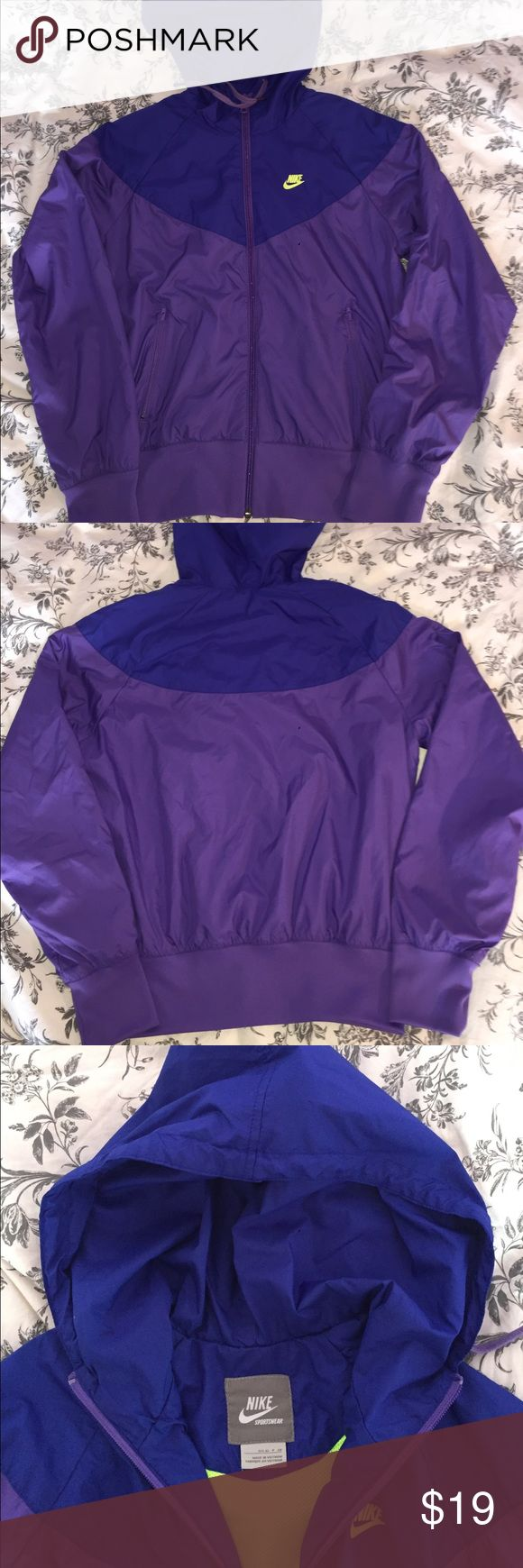 Purple, blue, and bolt Nike windrunner From Nike running. Hardly worn, like new. The black dot is on my camera lens. Nike Jackets & Coats