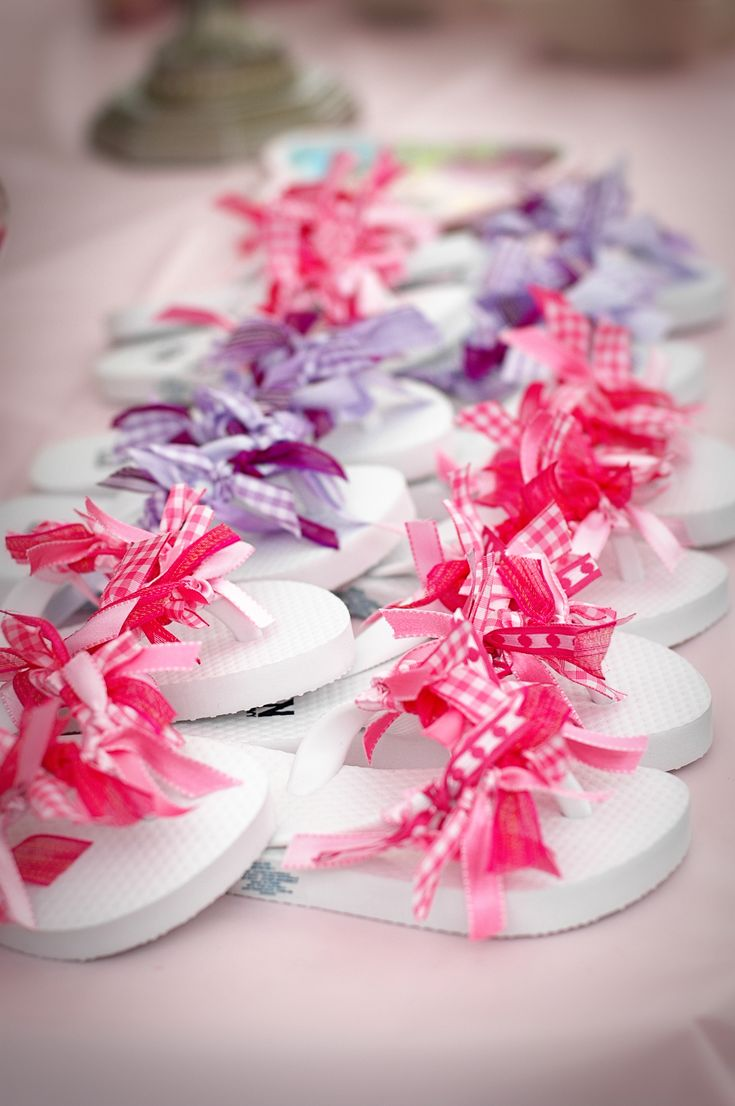 """Great summer craft idea for the kids.. 3-4 different coordinating patterns for each pair so about 1/2 yard or 2/3 of a yard per pattern for each pair.  Cut 14 5"""" pieces and tie them in double knots around the flip flops alternating patterns and you're done! :)"""