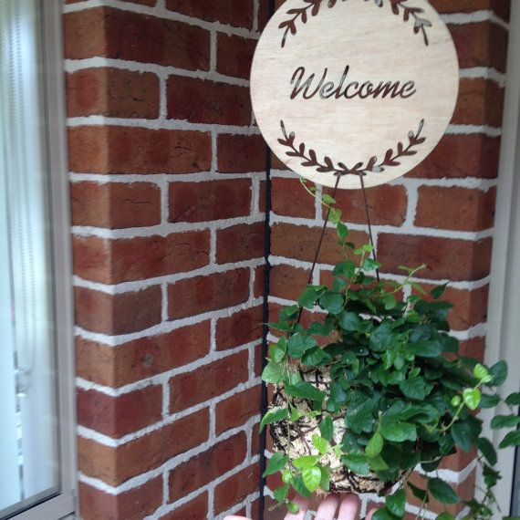 The cut out WELCOME timber plaque with wreath is created and designed by Katrina Louise Designs for Engagements, Weddings, gifts and decorations.