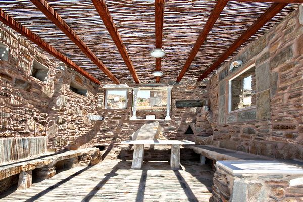 Half covered terrace with dining table with pool and sea view in a #holiday house in Tinos http://www.tinos-habitart.gr/orange-house.php