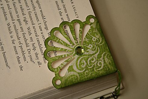 "Bookmark (cut 3"" strip & punch with Martha Stewart punch; cut down strip to 1 3/4"" from bottom of fan; fold edges up on back to make corner; put charm in; glue down overlapping papers on the back)    ETA: I also inked it with distress ink when it was done.)"