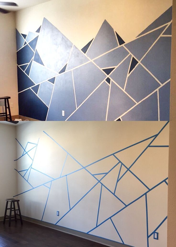 Abstract Wall Design. I used one roll of painter's tape and two shades of blue. The edges are rough so make sure the tape is secure on the wall or else you'll get bleeds between the lines! ☺️