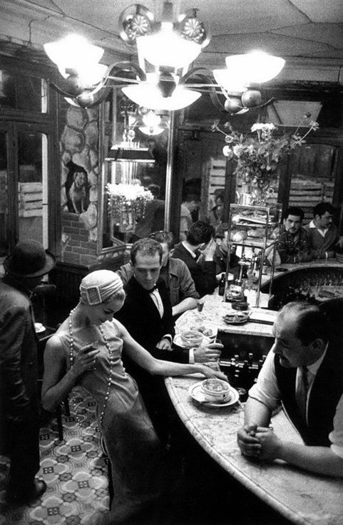 'Le Chien Qui Fume' by FRANK HORVAT, Paris, 1957 | flirting | restaurant | cafe | talking | vintage black & white photography | chandelier | France | French cafe scene  I already have this :-)