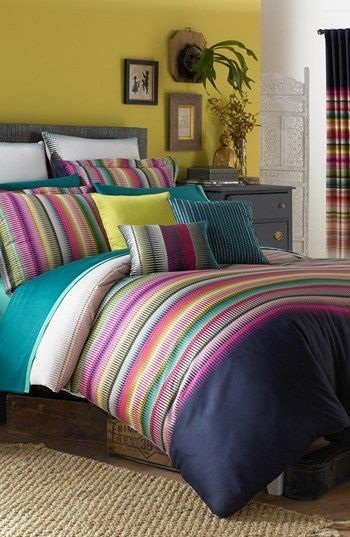 Love this bold & bright bedroom.