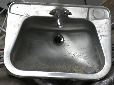 How To Clean Hard Water Spots From Stainless Steel. White Vinegar On A  Paper Towel