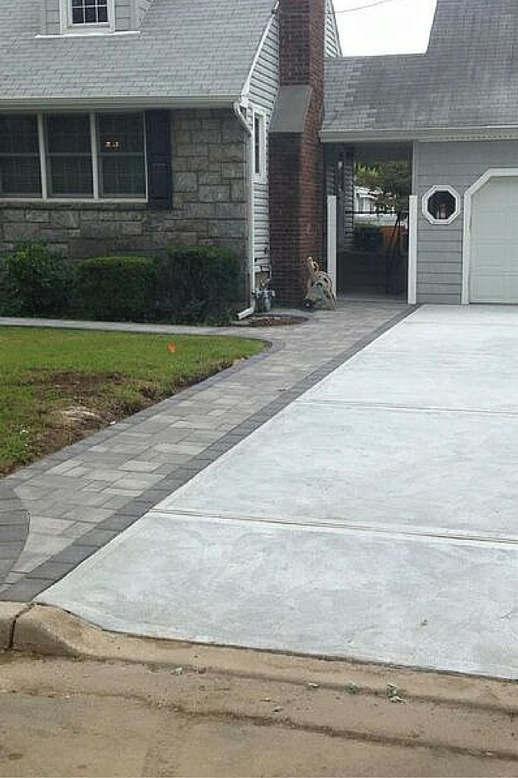 Create a beautiful driveway border with Cambridge Pavingstones. This driveway was installed by Fine Design Landscaping.