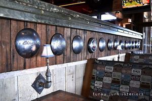 Hub cap heaven, complete with pipe lights! Visit more man cave decorating ideas by Funky Junk Interiors for #eBay