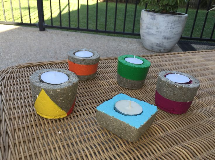 Our first attempt at painting self made Hypertufa candle holders.