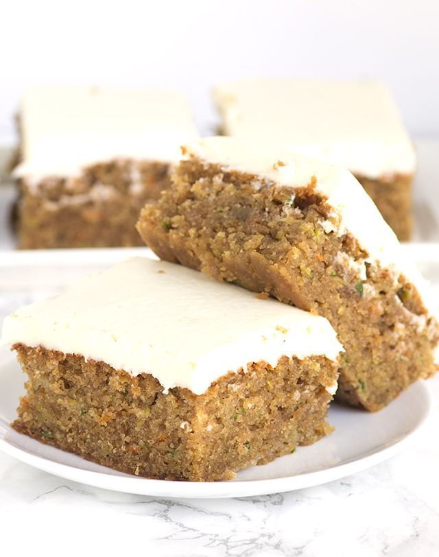 Peanut Butter Zucchini Squares - moist peanut butter squares full of shredded zucchini and carrots and topped with a cream cheese frosting.