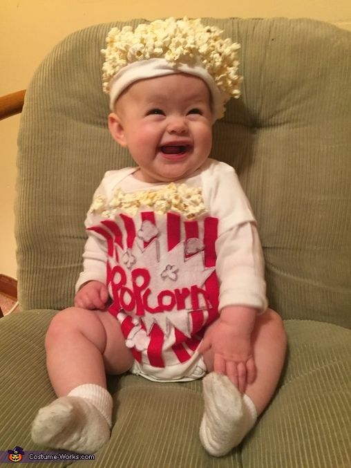 Sarah: My little girl wearing her popcorn Halloween costume. Instructions: Cut your white felt into a bag that fits the onesie Cut your red felt into long stripes that fit into...