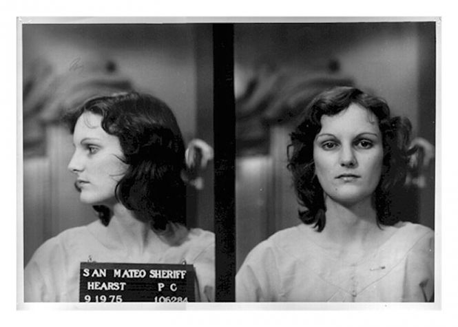 Patty Hearst, granddaughter of legendary newspaper publisher William Randolph Hearst, was photographed by the San Mateo County Sheriff in September 1975 after her arrest on bank robbery and gun charges. Hearst, kidnapped by the Symbionese Liberation Army in February 1974, was sentenced to seven years in prison. She was released in February 1979 after President Jimmy Carter commuted her sentence.