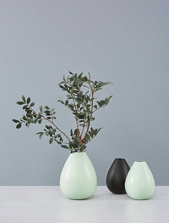 Vases in metal designed by Arne Jacobsen in 1960. Reintroduced by Design Letters in 2016 in two sizes and two colours. The iconic vase looks good with a single or few flowers - or with nothing in it at all. Made in Denmark.