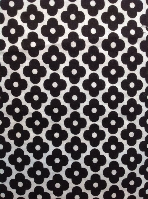 Black and White Mary Quant daisy printed Cotton by Anne Kelle for Robert Kaufman, 13.80 per metre. Maybe for a skirt