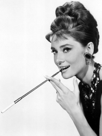 Audrey Hepburn is a classic beauty.  I'm not crazy about the cigarette, but the mischievous expression is a winner.