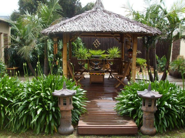 A Bali hut creates a space to display wood carvings and traditional Balinese furnishings.