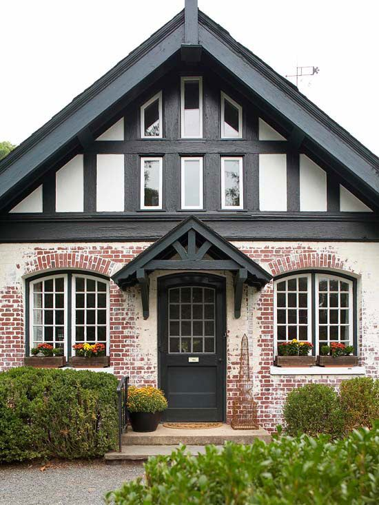 Black awnings provide pretty contrast to this cottage home. More of our favorite facades: http://www.bhg.com/home-improvement/exteriors/curb-appeal/enhance-front-entry/?socsrc=bhgpin041013blackawnings=12