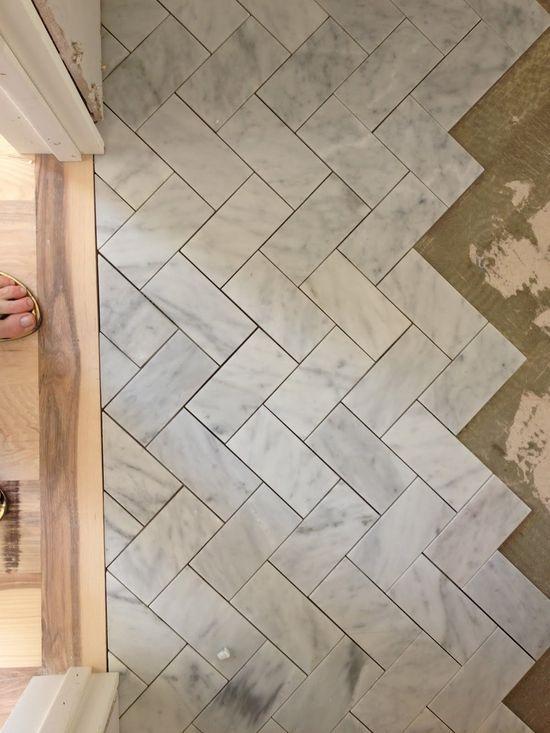 herringbone floor subway tile - bathroom
