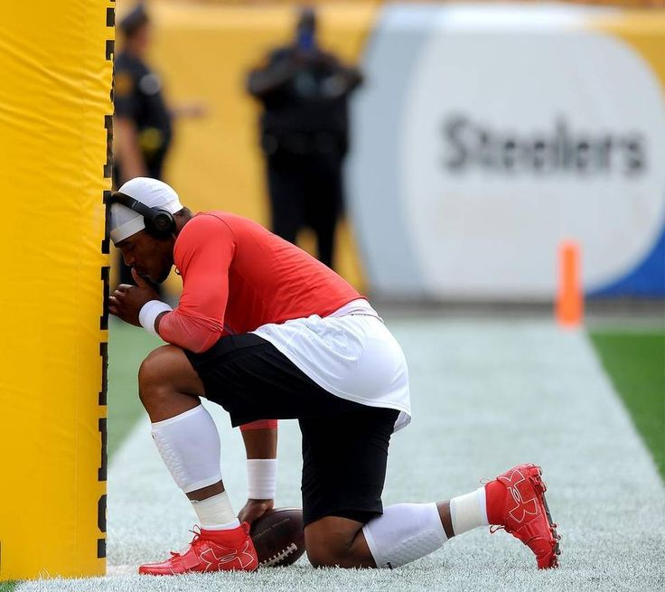 Carolina Panthers quarterback Cam Newton kneels in prayer at a goal post at Heinz Field prior to the team's preseason game vs the Pittsburgh Steelers on Thursday, September 3, 2015 in Pittsburgh, PA.