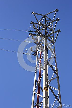 Electricity pylon on the clear blue sky background.