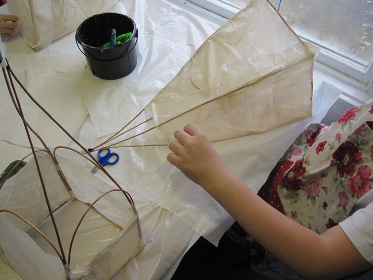 Making paper lanterns from twigs and paper.