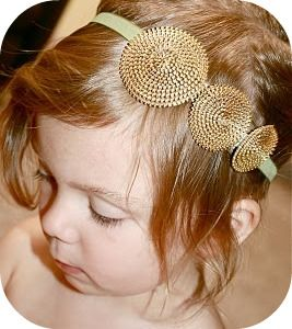 Zipper rosettes can attache to headbands, earrings, necklaces, frames and more
