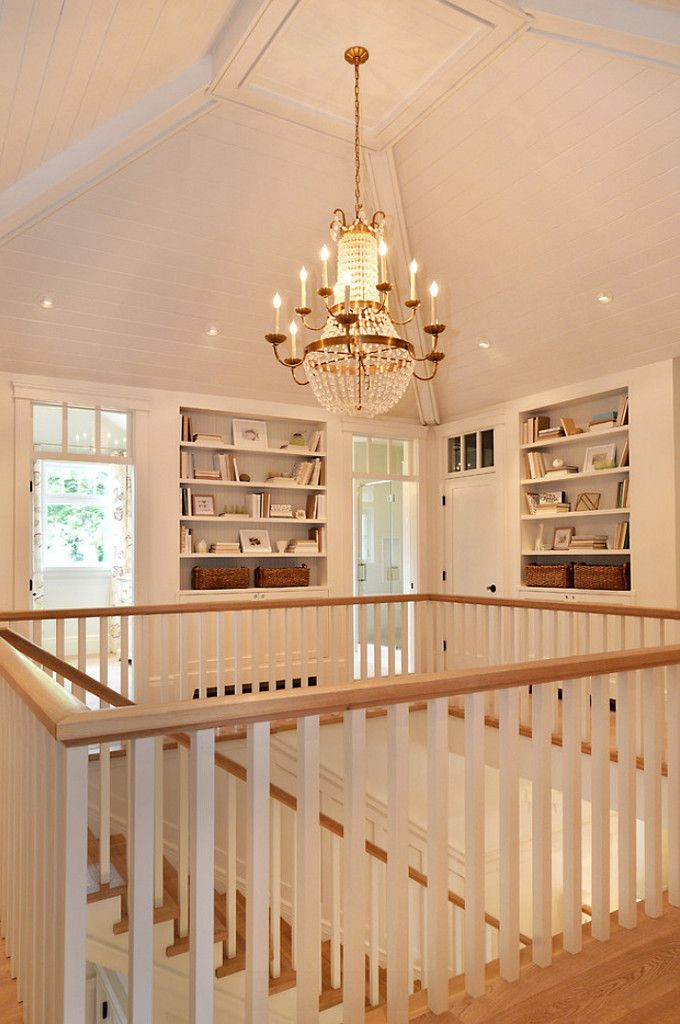 Love how this upstairs landing has built-in bookshelves! Seaglass Cottage via Walter Powell Architects