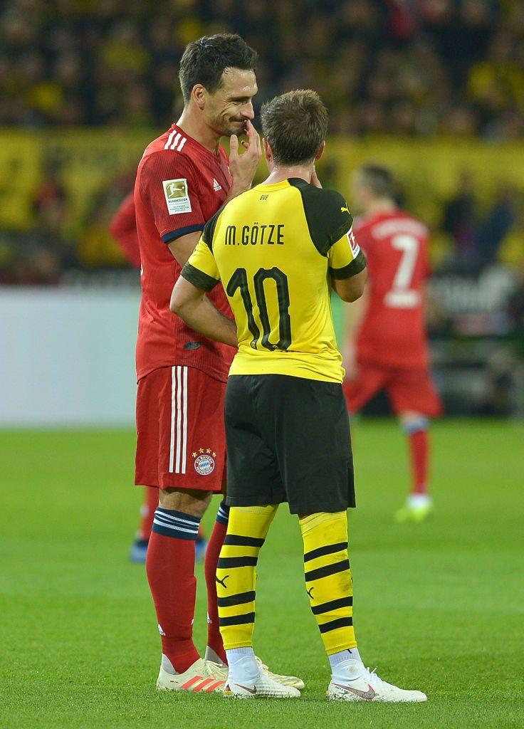 Dortmund Germany November 10 Mats Hummels Of Bayern Muenchen Speak With Mario Goetze Of Borussia Dortmund During Th Borussia Dortmund Bvb Dortmund Dortmund