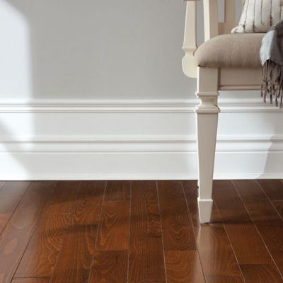 With the strategic use of paint and moulding, you can build up your baseboards for an exaggerated, high-style look. #DIY
