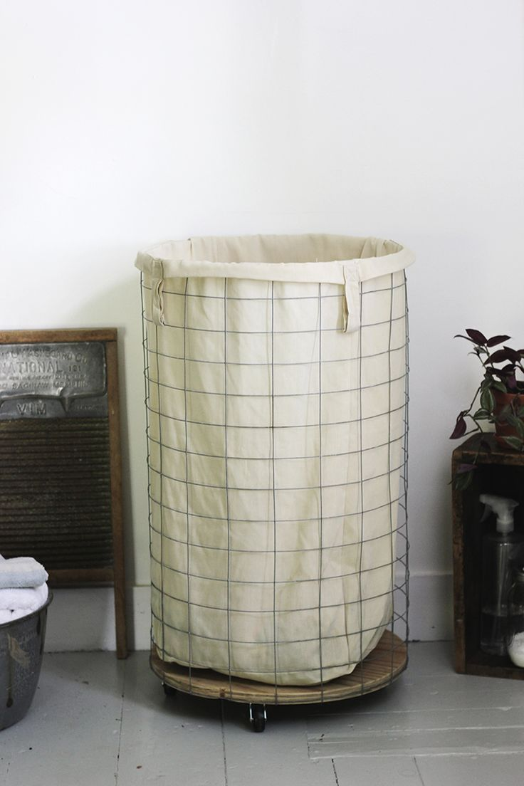 Love this #DIY Wire Laundry Hamper by @themerrythought. #bathroom #organization