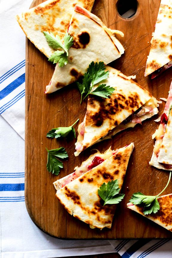 Thinking about Thanksgiving leftovers? Try making turkey cranberry quesadillas with ham + brie. They're packed with flavor and fun to eat!