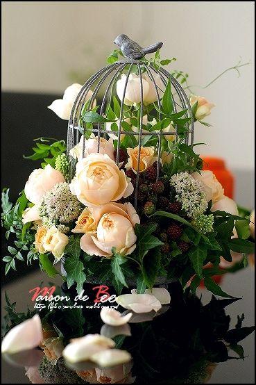 Flower Arrangement With A Birdcage