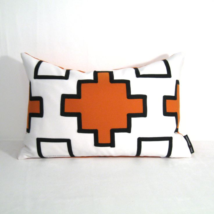Orange and white geometric Sunbrella pillow for indoor or outdoor spaces.  #GeometricPillow #OrangeOutdoorPillow #SunbrellaPillow #ModernOutdoorPillow #mazizmuse
