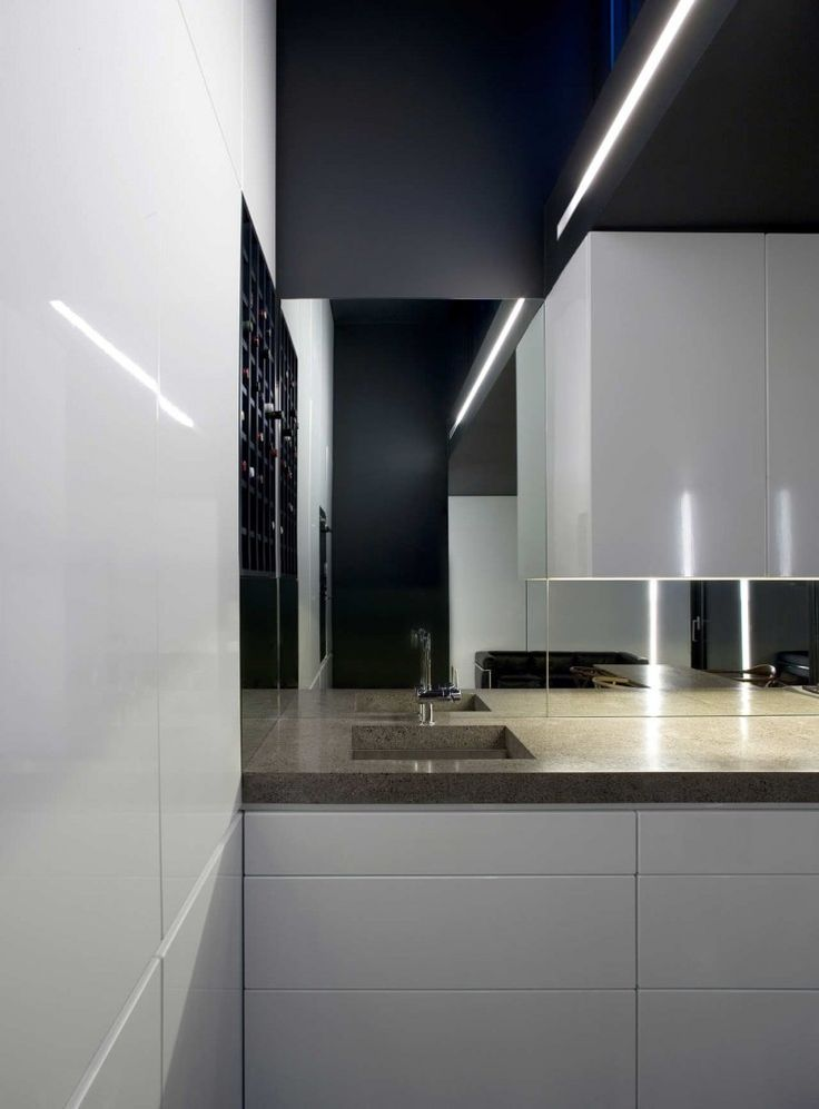 :: KITCHENS :: simple detail by ODOS architects, featured on archdaily.  Clever way of utilizing corner storage and creating a simple focal point, i don't usually like mirror, reminds me of the bad 80's but this application looks great, use of black, mirror aligned with the top of flush cabinetry, integrated lighting - great detail  Architects: ODOS architects  Location: Dublin, Ireland  Engineers: Cora  Internal Floor Area: 190 sqm (per dwelling unit)  #kitchens